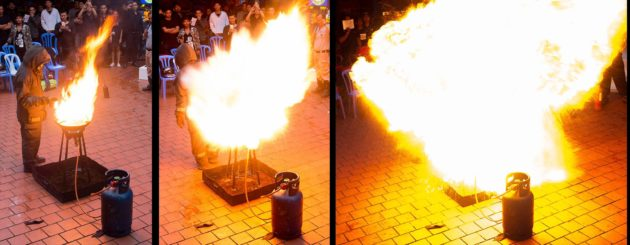 A fireball is created by pouring water on a grease fire.